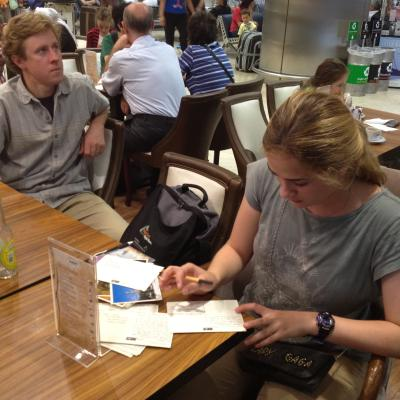 Sean at the Istanbul airport writing postcards while Todd waits