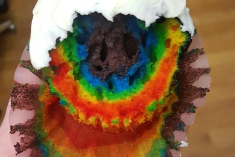 Rainbow colored cupcake