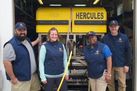 Group shot of Nautilus Ambassadors with ROV Hercules